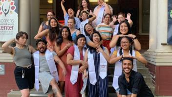 Funny photos of WRRC Scholars in their stoles on the front steps of the WRRC